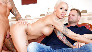 MILF Wife Sophie Logan Summons a Stallion to Show Her Hubby How to Fuck