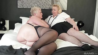 Chubby matures Succulent Ginger and Lexie Cummings play with a dildo