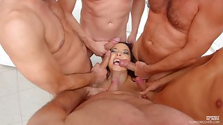 MILF Belle Francys on her knees getting mouth fucked by a buckle of men
